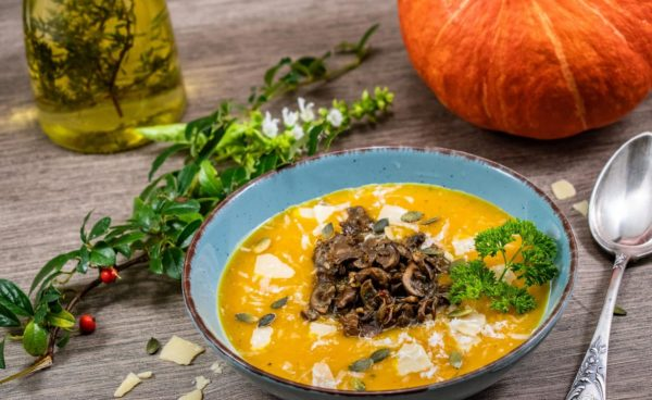 Creamy pumpkin soup with mushrooms